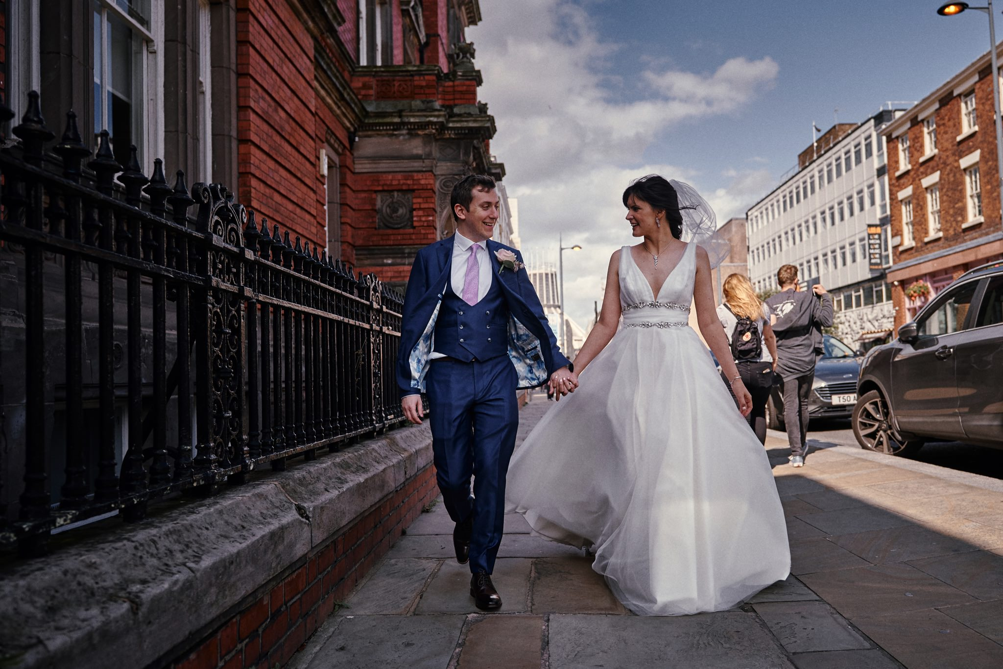 Bride and groom walking down Hope Street Liverpool