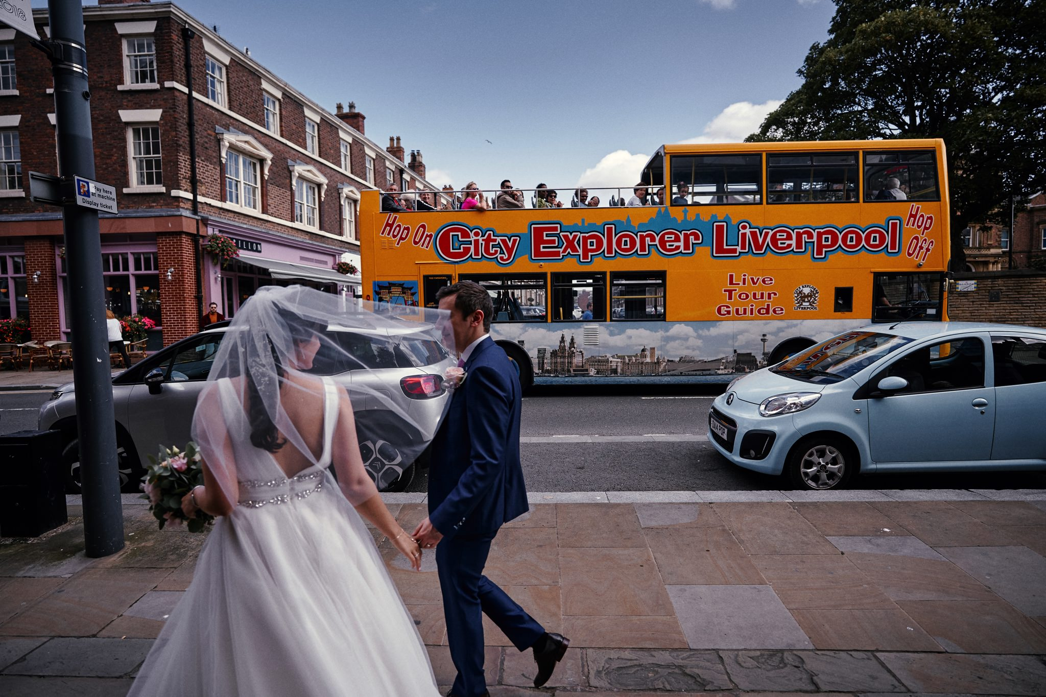 Liverpool open top bus waves to our Bride and Groom