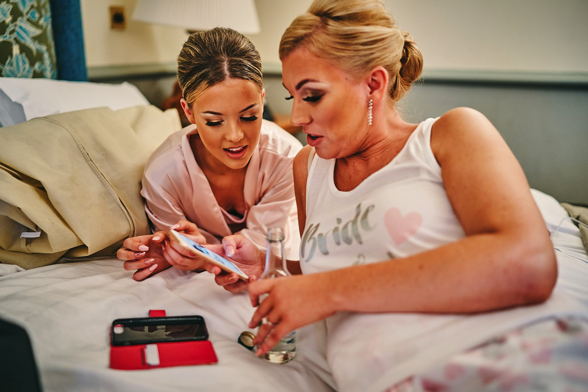 Bride and her daughter check their phones