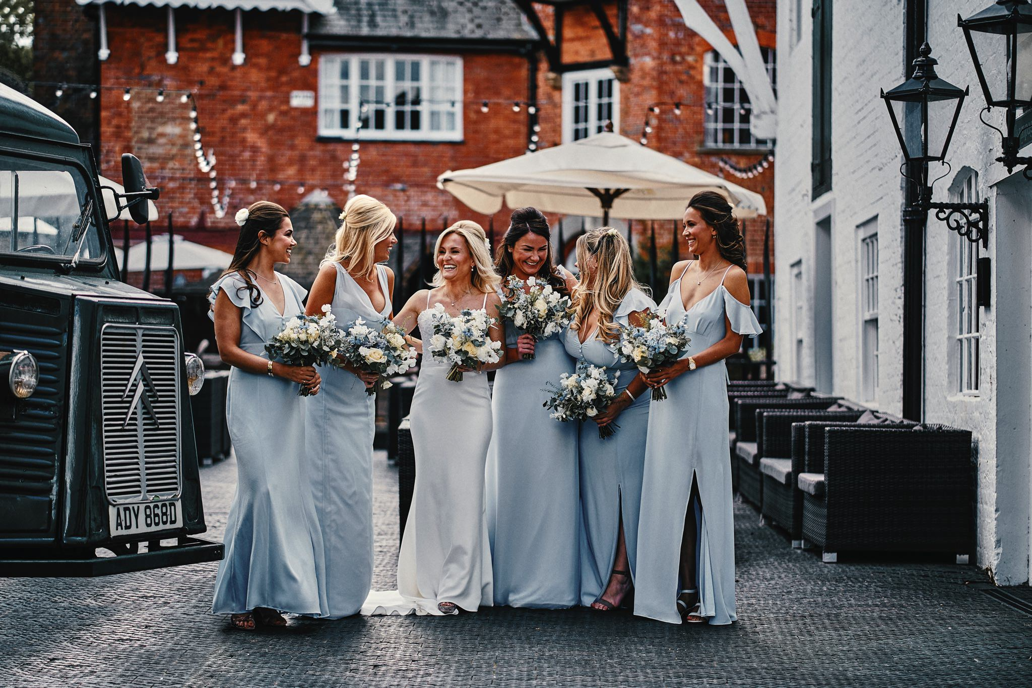 Bride and Bridesmaids pose for a group-shot outside the Hotel Du Vin, Henley-on-Thames