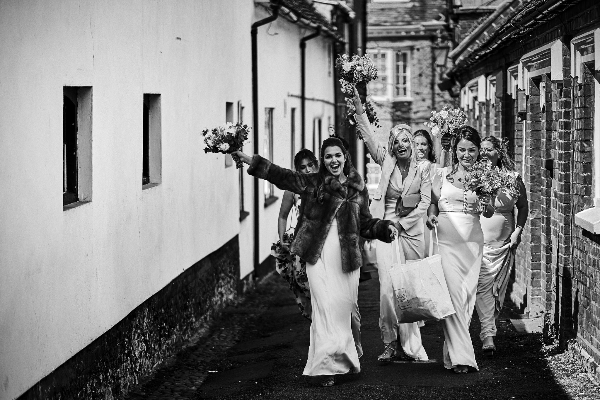 Bridal party make their way to St Mary's church, Henley-on-Thames