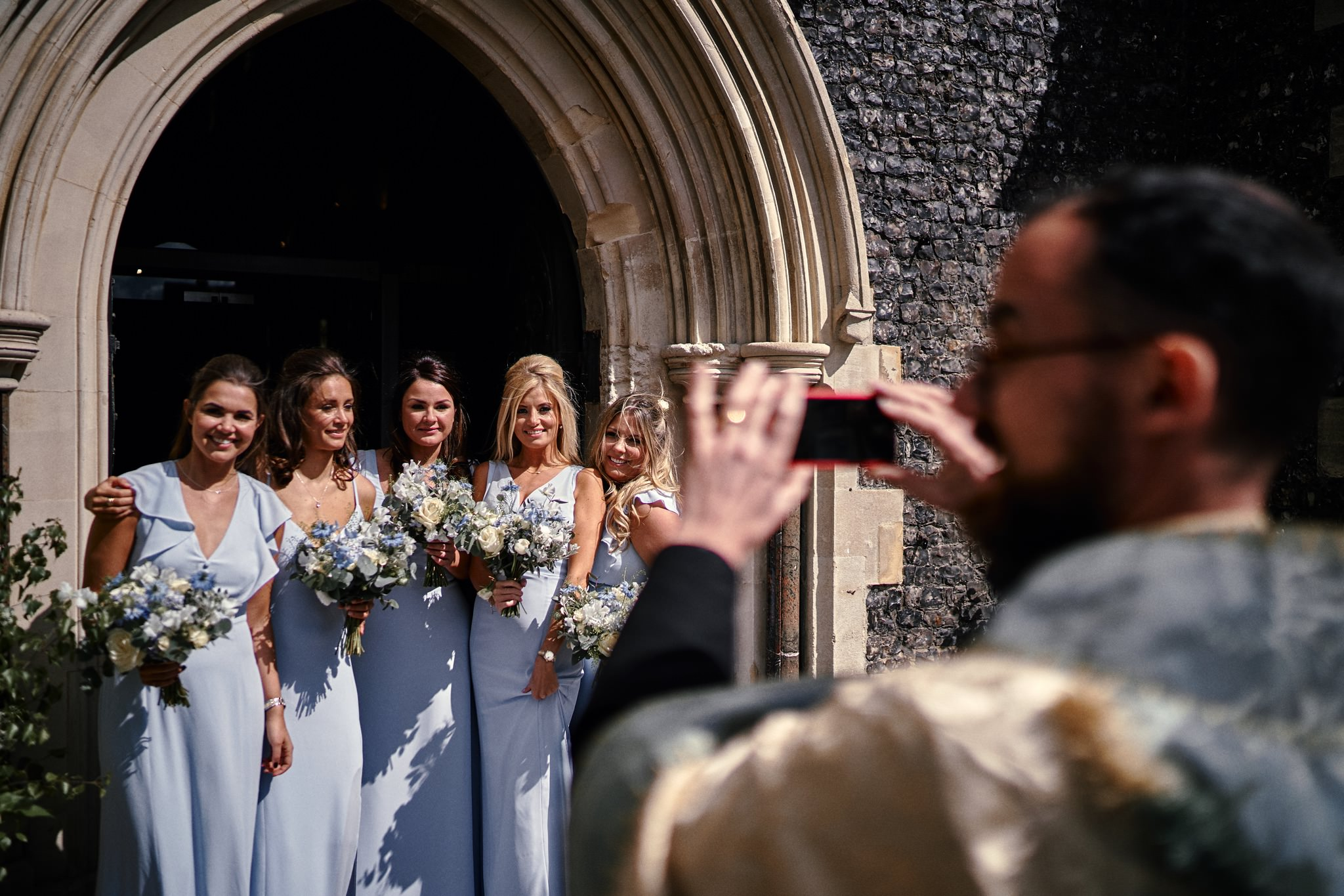 Bridesmaids pose for a selfie with the Vicar at St Mary's church, Henley-on-Thames