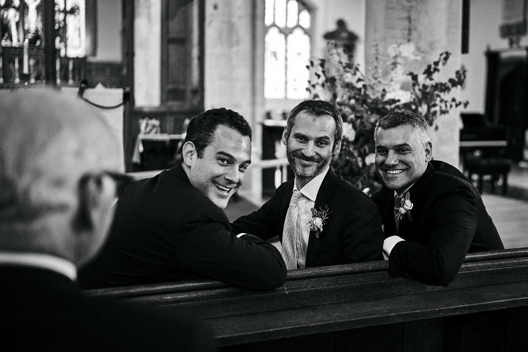 Groom and his ushers share a joke waiting for the Bride at St Mary's church, Henley-on-Thames