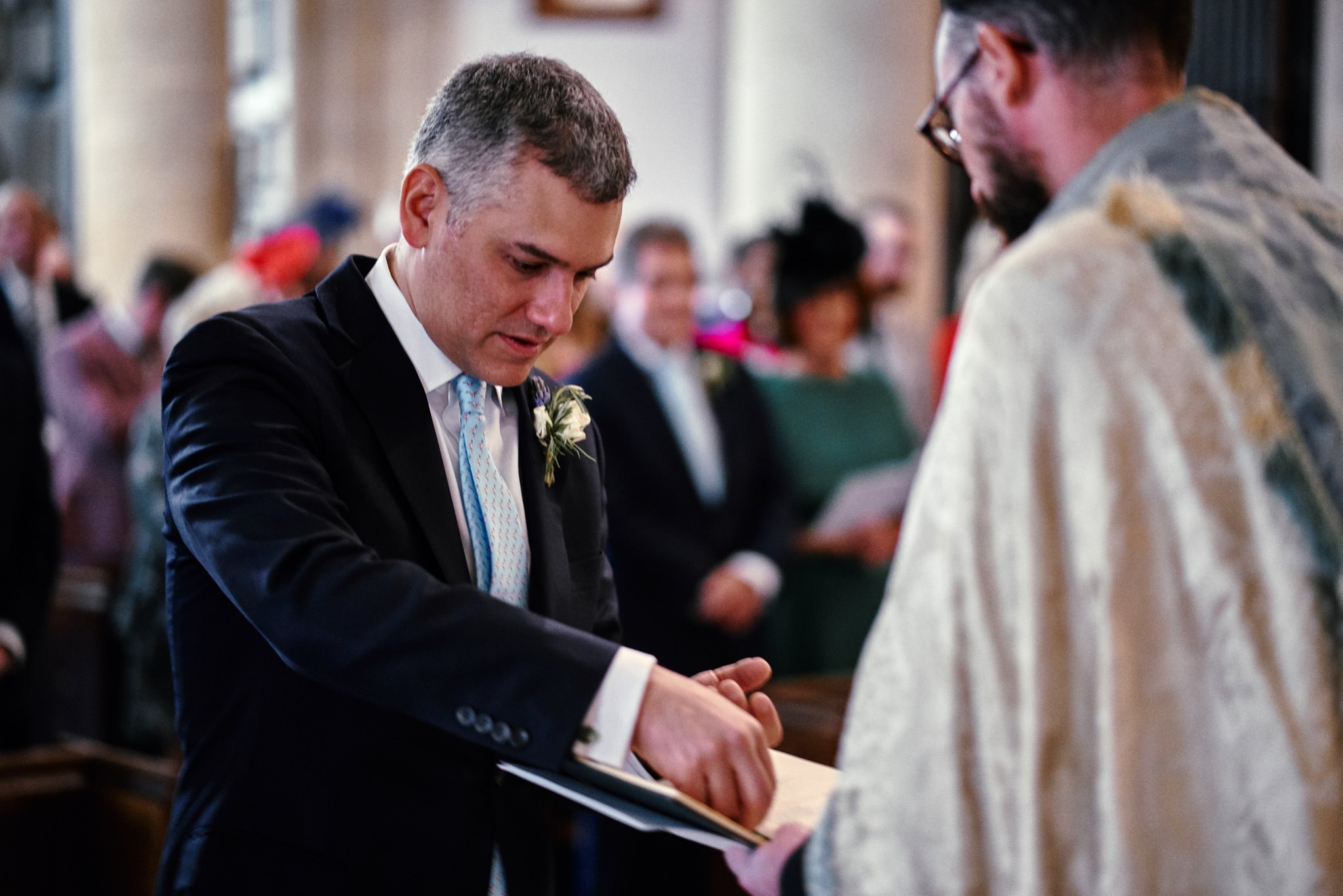 Best man delivers rings during wedding service at St Mary's Church, Henley-on-Thames