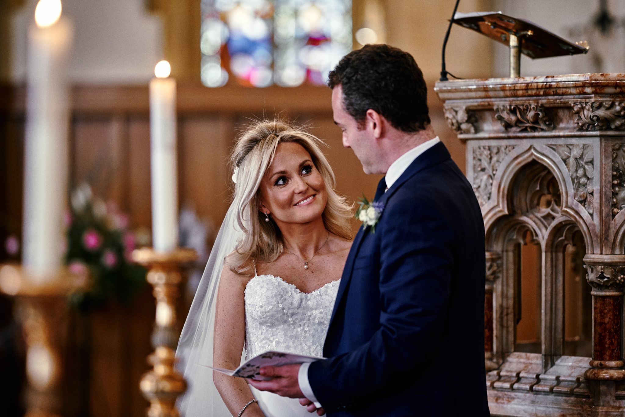 Bride and Groom during a wedding service at St Mary's Church, Henley-on-Thames
