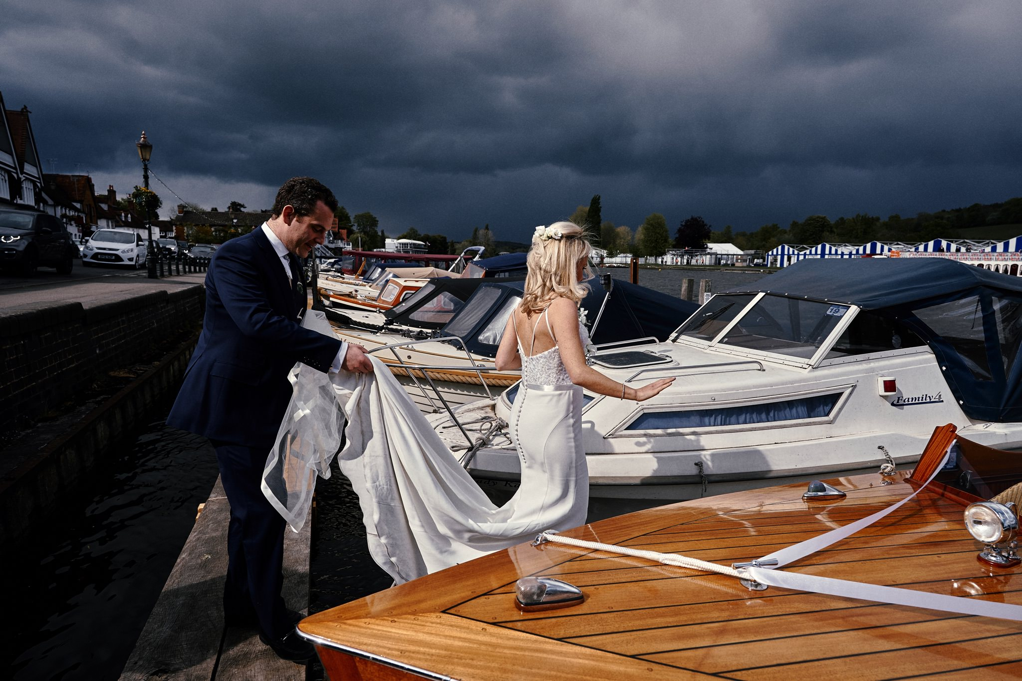 Bride and groom board wedding boat in Henley-on-Thames