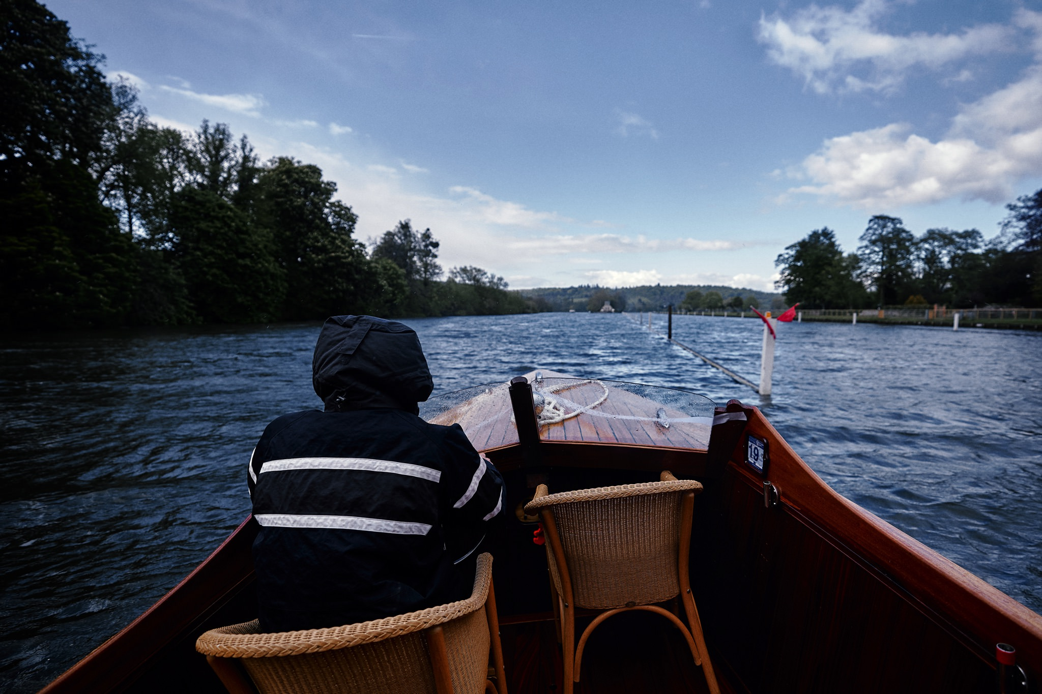 Skipper steers the wedding boat towards Temple Island, Henley-on-Thames