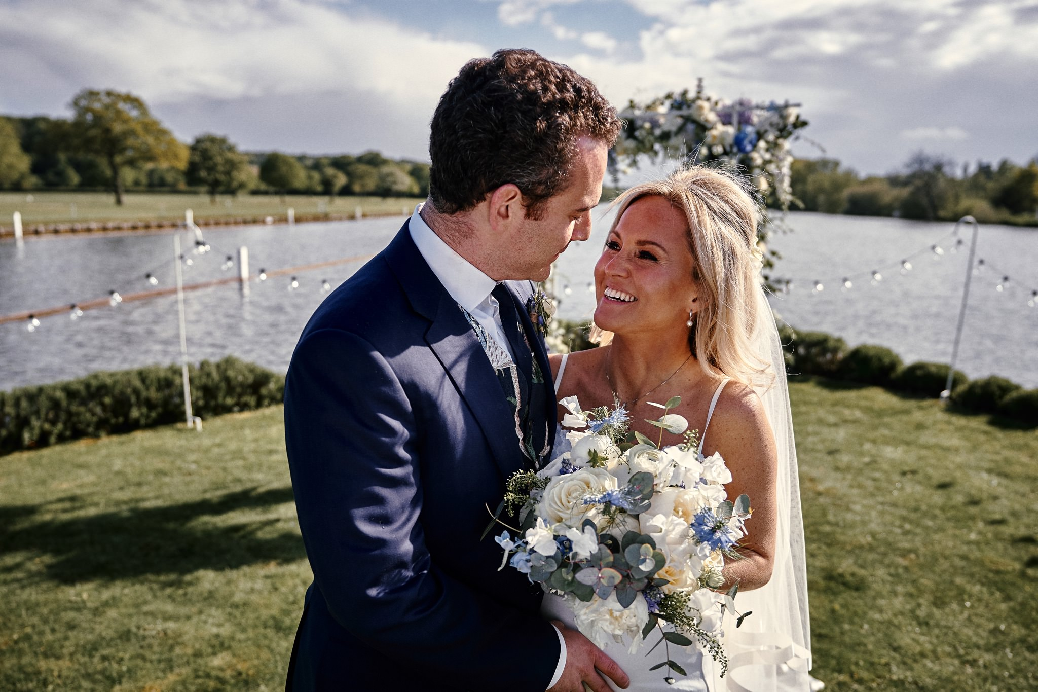 Bride and groom pose in front of Flower Arch on Temple Island, Henley-on-Thames