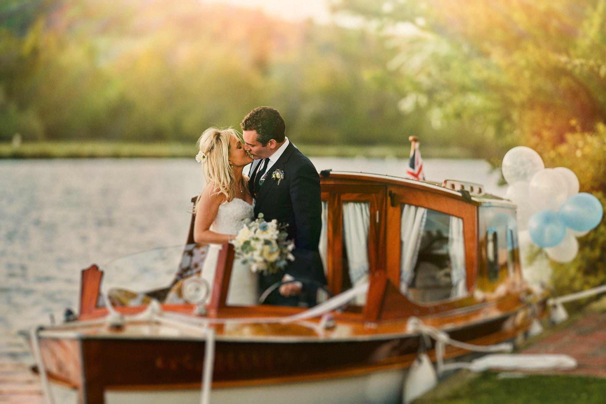 Bride and Groom on boat moored at Temple Island on the Thames