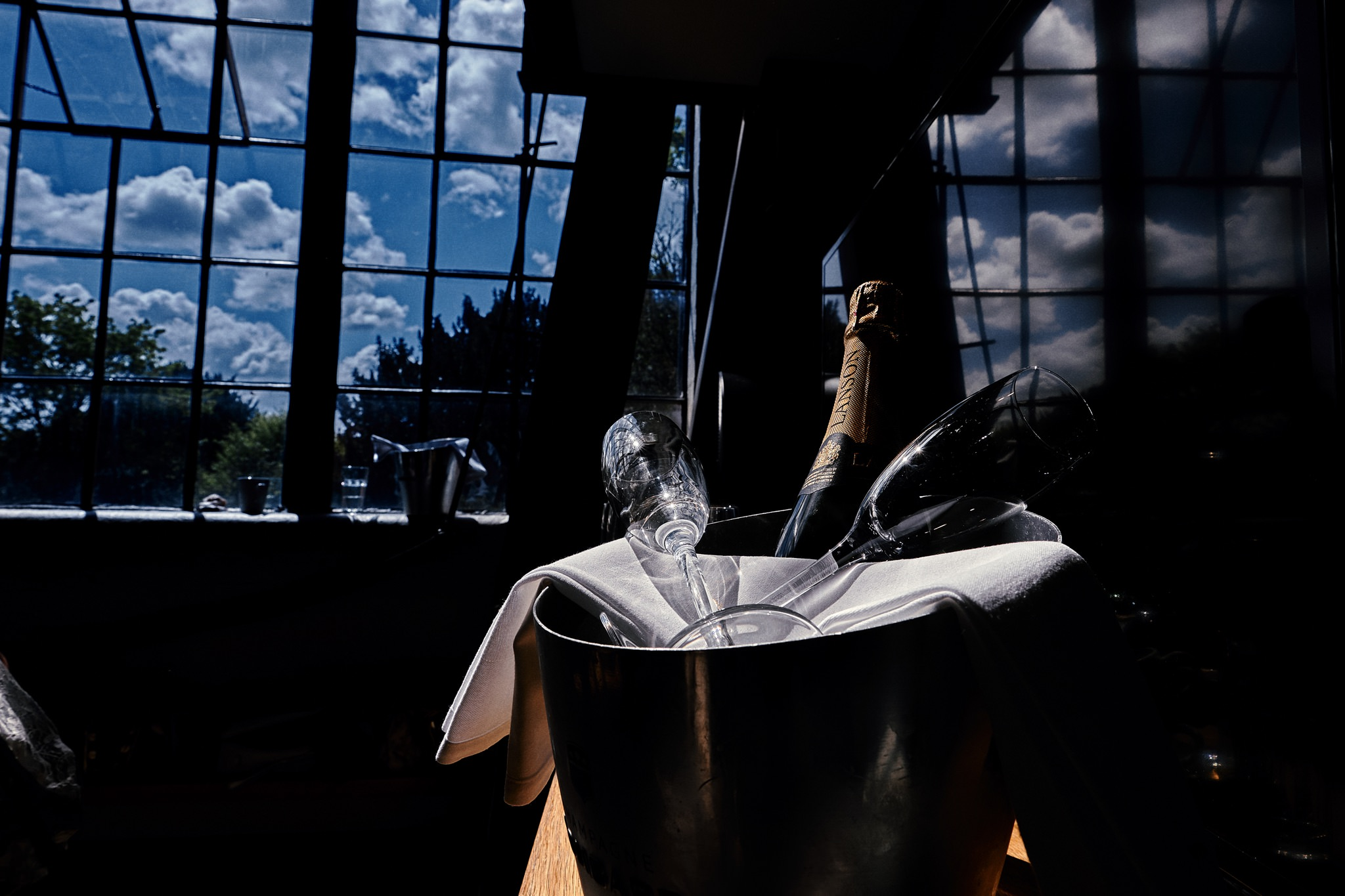 Champagne lined up during Bride prep at Hotel Du Vin, Henley-on-Thames