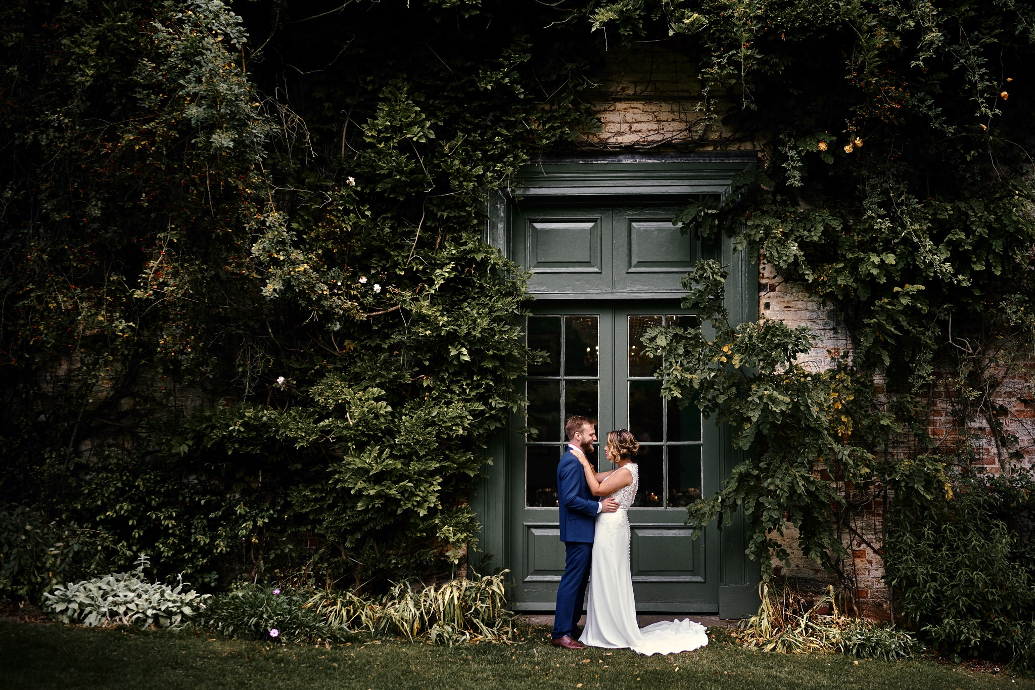 Bride and groom portraits in the garden at the beautiful Walcot Hall Hotel, Shropshire.