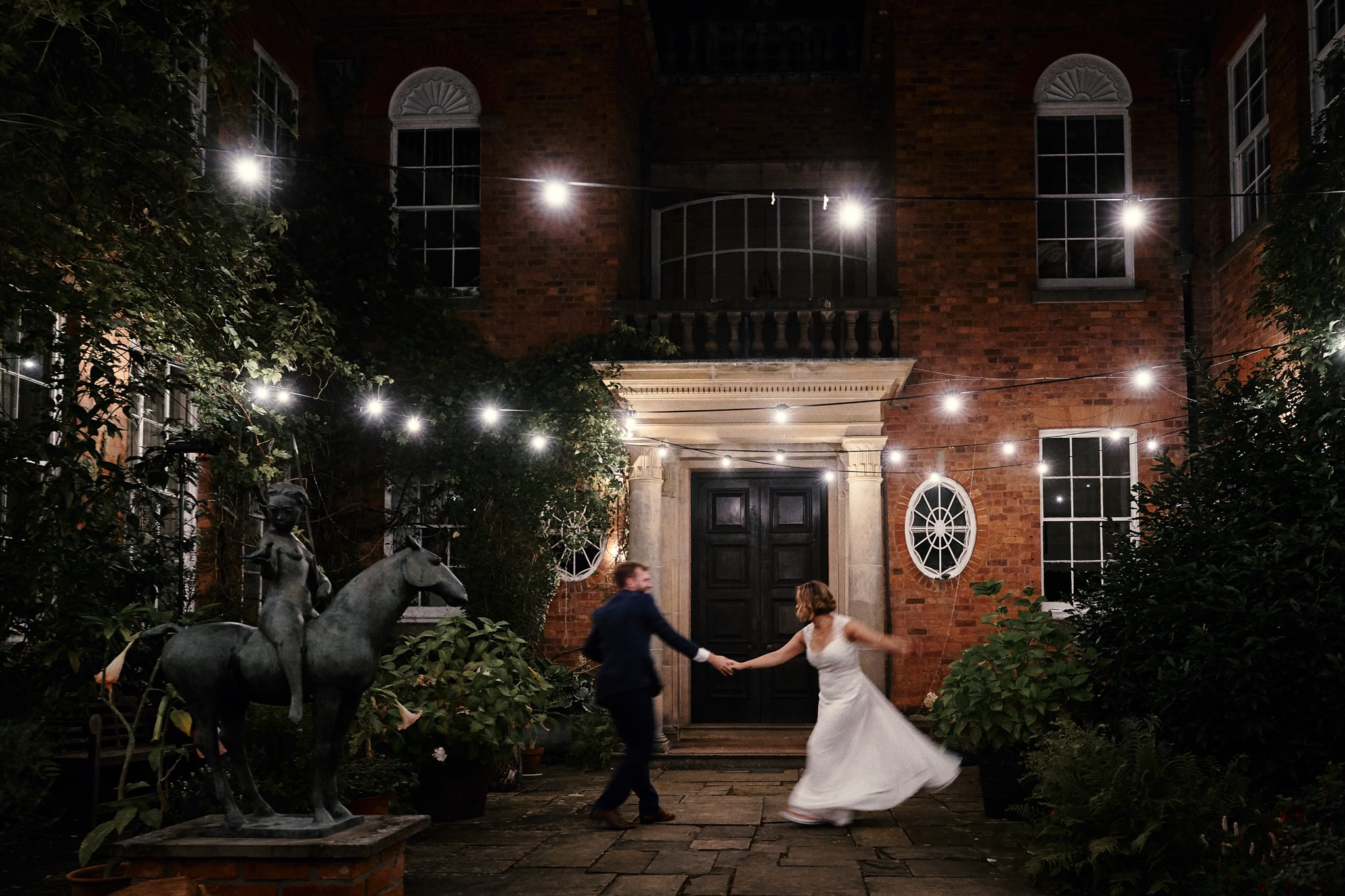 Bride and Groom dance outside at Walcot Hall, Shropshire