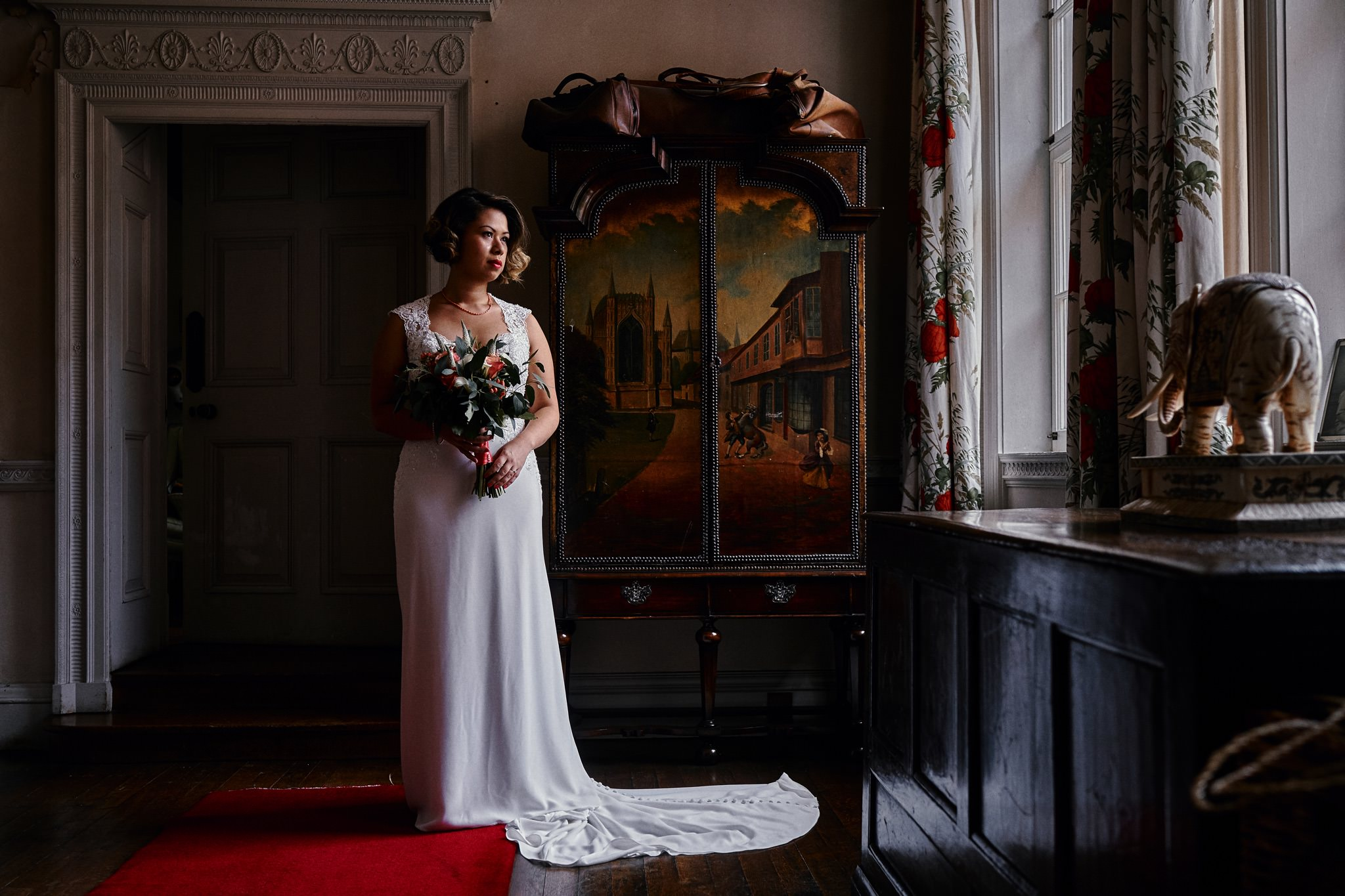 Beautiful bride poses in the Walcot Hall Hotel, Shropshire.