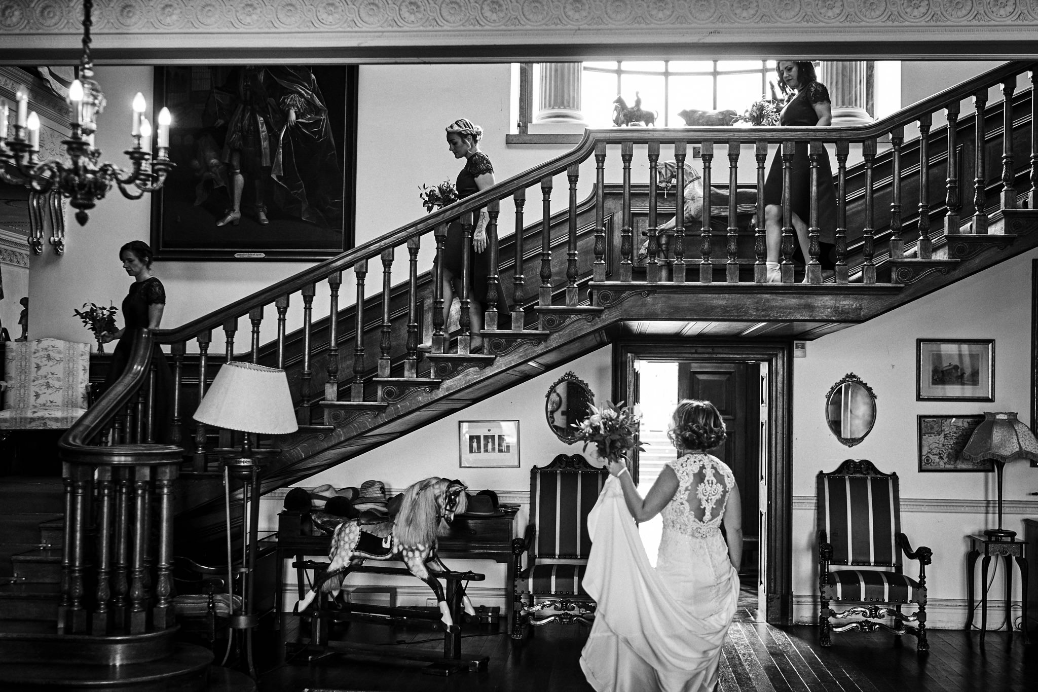 Bridal party on their way to ceremony at Walcot Hall Hotel, Shropshire.