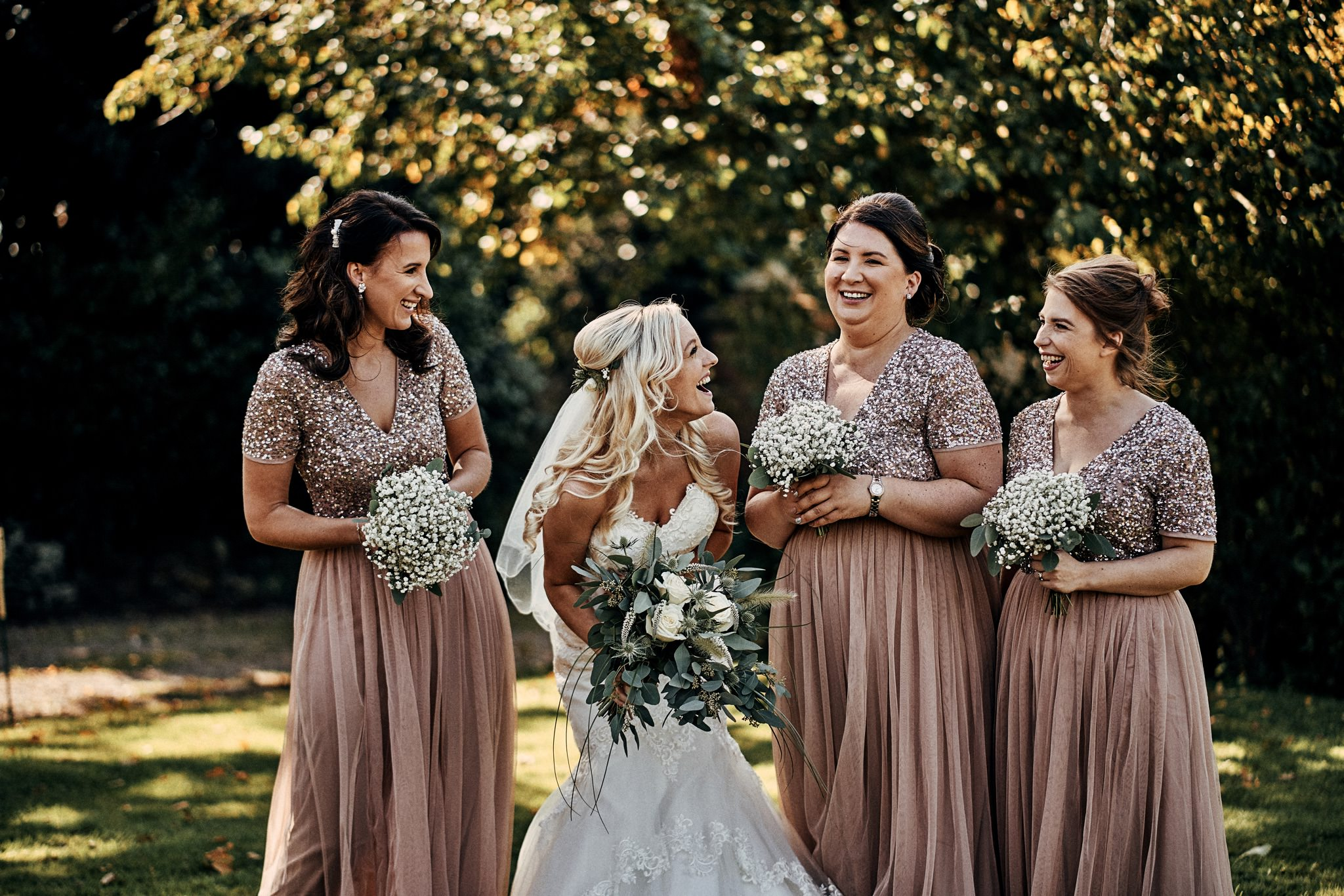 Bridal party share a joke during the formal photos