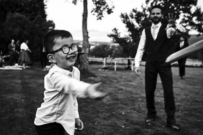 Child at wedding throwing frisbee